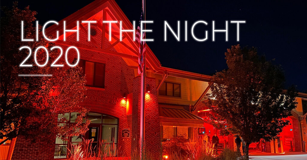 "fire station glows red, ""light the night 2020"""