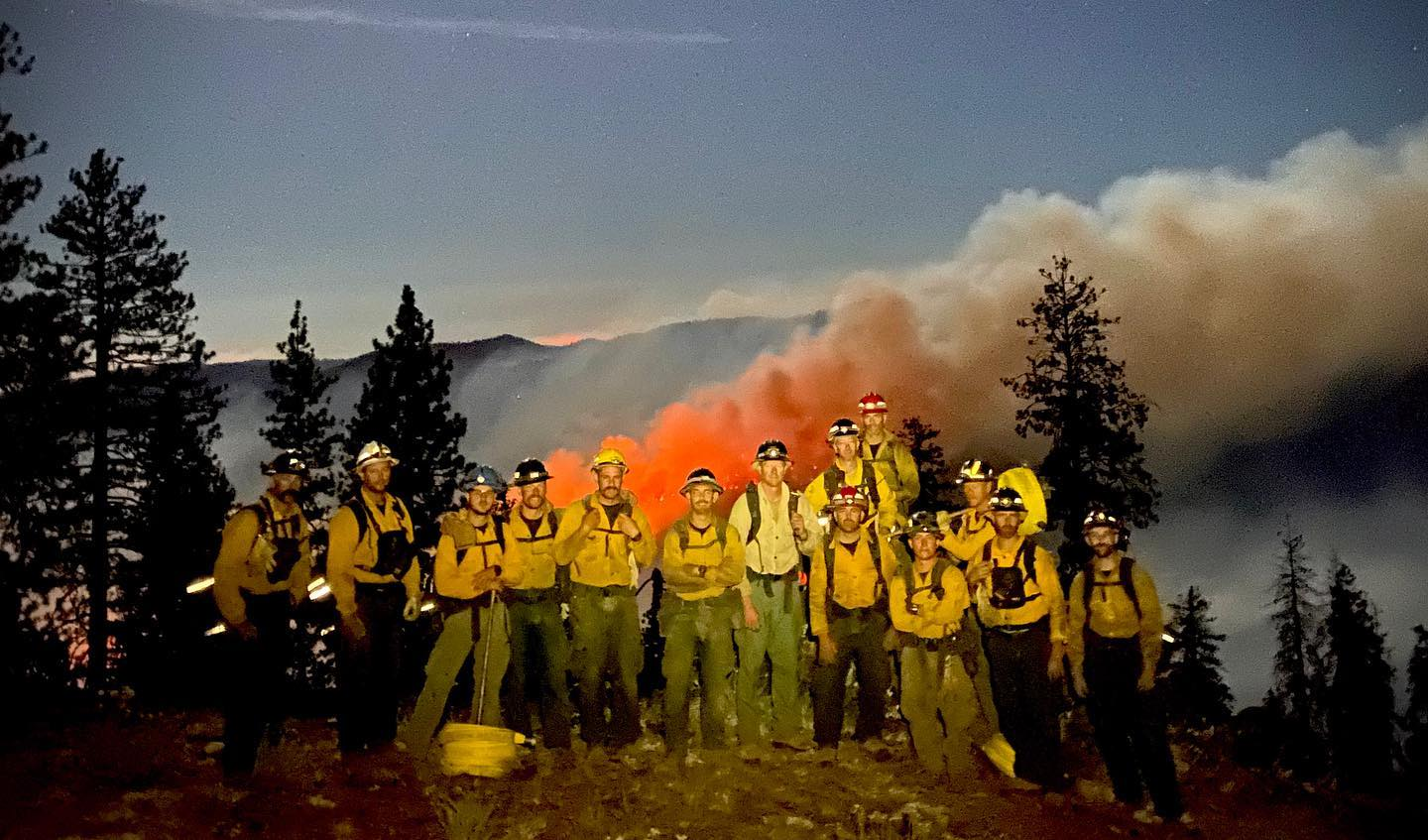 Task force standing in front of fire