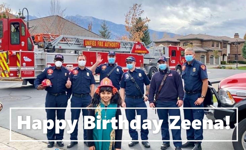 Happy Birthday Zeena, girl stands in front of fireifghters